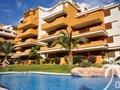 Appartement in Punta Prima met garageplek en balkon bij zandstrand en 3 zwembaden