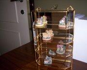 glazen hangschapje met miniatuurhuisjes