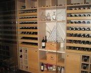 1 lot van 261 flessen wijn bewaard in een wijnkamer