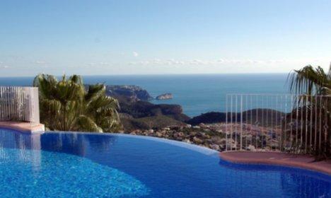 23b/zeezicht-vanuit-appartement-in-moraira-bij-zwembaden.jpg